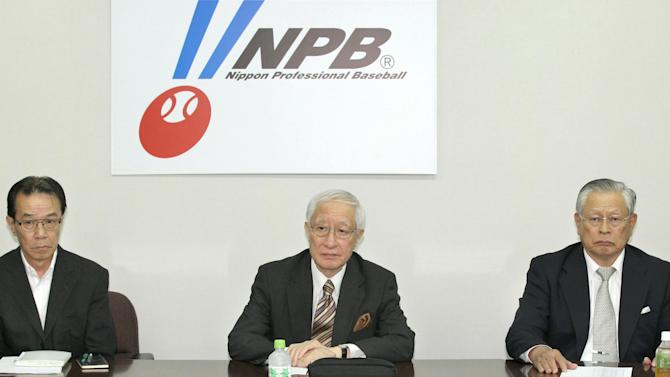 Nippon Professional Baseball commissioner Ryozo Kato, center, attends a a meeting with representatives of the 12 teams in Tokyo Friday, June 14, 2013. Kato apologized for the confusion caused by introducing a new, livelier ball this season without notifying players. NPB acknowledged this week for the first time that a new ball was introduced at the start of the season, resulting in a sharp increase in home runs. Japan's 12 teams agreed to have a third party investigate the issue of why NPB secretly made its baseballs livelier. (AP Photo/Kyodo News) JAPAN OUT, MANDATORY CREDIT