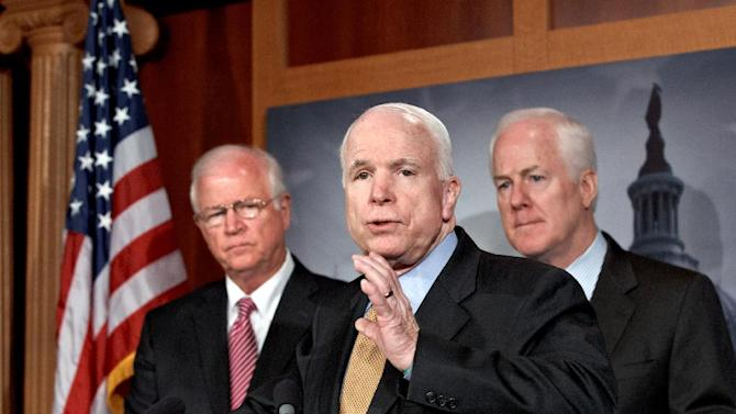 From left, Sen. Saxby Chambliss, R-Ga., vice chair of the Senate Intelligence Committee, Sen. John McCain, R-Ariz., and Sen. John Cornyn, R-Texas, take turns at the microphones to assert their belief that President Obama's administration has orchestrated disclosure of classified information for political gain, during a news conference on Capitol Hill in Washington, Tuesday, June 26, 2012.  (AP Photo/J. Scott Applewhite)