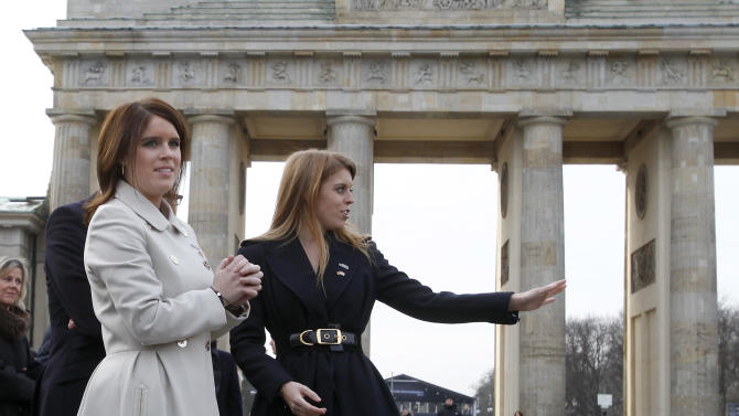 Members of the British royal family, Princess Beatrice of York, right, and Princess Eugenie of York, left, arrive for a promotion event for the Great Britain MINI Tour 2013 at the Brandenburg Gate in Berlin, Germany, Thursday, Jan. 17, 2013. It was meant to be a Mini adventure that nearly became a major embarrassment.Two British royals on a mission to promote their country broke German road rules by running a red light near Berlin's iconic Brandenburg Gate. With photographers and police in tow, Princess Eugenie and her older sister Princess Beatrice then took a swift right into the safety of the British embassy compound.  At least the 22 and 24-year-old sisters didn't have to decide which side of the road to drive on. The entire 500-meter (550-yard) staged tour was along one-way streets. (AP Photo/Michael Sohn)