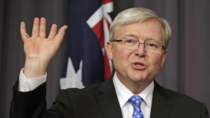 Kevin Rudd speaks to the media following a leadership ballot for the Labor Party at parliament in Canberra, Australia, Wednesday, June 26, 2013. Australian Prime Minister Julia Gillard was ousted as Labor Party leader by her predecessor, Rudd, in a vote of party lawmakers hoping to avoid a huge defeat in upcoming elections. (AP Photo/Rick Rycroft)