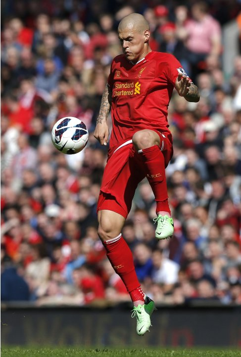 Liverpool's Skrtel jumps for the ball during their English Premier League soccer match against Queens Park Rangers at Anfield in Liverpool