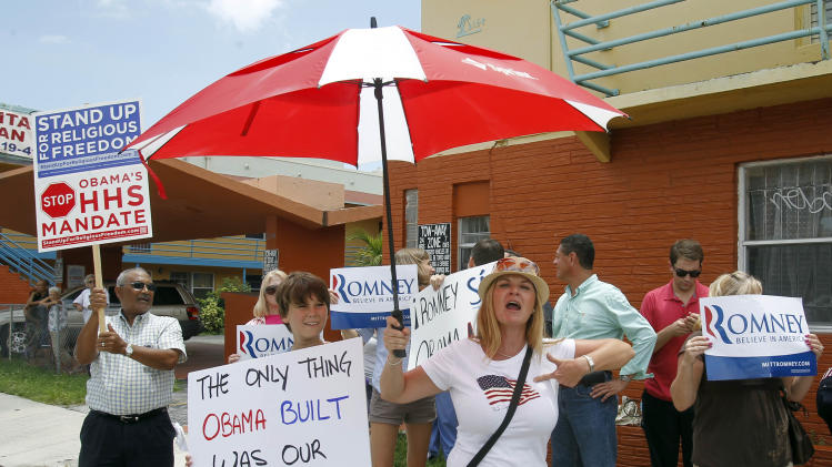 A group of Mitt Romney supporters protest the opening of a new Obama For America-Florida office in the Little Havana area of Miami, Thursday, Aug. 2, 2012. Romney's Republican campaign is joining Obama's Democratic effort in stepping up the outreach to the I-4 corridor, where the majority of Florida's Puerto Ricans live. (AP Photo/Alan Diaz)