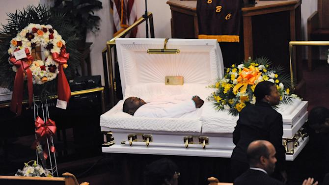 FILE - In this July 23, 2014 file photo, Eric Garner's body lies in a casket during his funeral at Bethel Baptist Church in the Brooklyn borough of New York. Garner died in police custody after an officer placed him in an apparent chokehold. Staten Island District Attorney Daniel Donovan announced Tuesday, Aug. 19, 2014, that an extra grand jury will be impaneled to hear evidence next month in the July 17 death of Garner. Donovan says his decision is based on his office's investigation and the medical examiner's ruling that the death was homicide. (AP Photo/New York Daily News, Julia Xanthos, Pool, File)