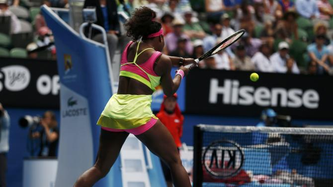 Williams of the U.S. hits a return to compatriot Keys during their women's singles semi-final match at the Australian Open 2015 tennis tournament in Melbourne