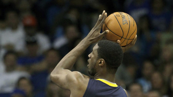 Indiana Pacers' Roy Hibbert (55) shoots over Orlando Magic's Glen Davis (11) during the first half of Game 4 of an NBA first-round playoff basketball series, Saturday, May 5, 2012, in Orlando, Fla. (AP Photo/John Raoux)