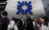 People walk past a branch of the Royal Bank of Scotland (RBS) in central London, 2011. State-rescued Royal Bank of Scotland was battling to repair an already battered reputation as it struggled to fix a week-old computer glitch that has affected millions of customers