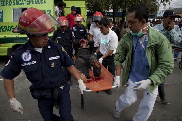 Firefighters transport a wounded resident into a public hospital after he was injured in a magnitude 7.4 earthquake that struck in San Marcos, Guatemala, Wednesday Nov. 7, 2012. The mountain village,