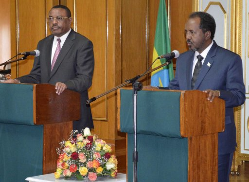 Somalia's newly elected President Hassan Sheikh Mohamud addresses a news conference with Ethiopian PM Desalegn in Addis Ababa