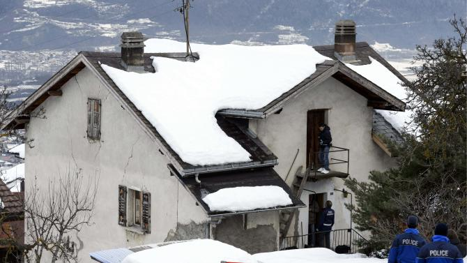 Policemen investigate the house of the gunman and the shooting scene after a shooting in Daillon, Switzerland, Thursday, Jan. 3, 2013. A man shot and killed three people and wounded another two in the Swiss village, and was then arrested by officers who shot and injured him, police said Thursday. Police in the southern canton (state) of Valais said they were alerted to the shooting in the village of Daillon just before 9 p.m. (20:00GMT) Wednesday. Three of the victims died at the scene and the two injured people were taken to hospitals. A police statement early Thursday gave no detail on their injuries. (AP Photos/Keystone, Laurent Gillieron)