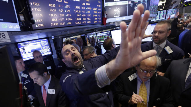 FILE - In this June 18, 2014 file photo, specialist Peter Giacchi calls out prices during the IPO of Foresight Energy on the floor of the New York Stock Exchange. A strong U.S. economy helped propel the stock market higher for a fifth-straight year in 2014. (AP Photo/Richard Drew, File)