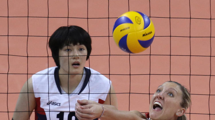 United States' Jordan Larson, right, controls the ball as South Korea's Kim Hee-jin watches during a women's semifinal volleyball match at the 2012 Summer Olympics, Thursday, Aug. 9, 2012, in London. (AP Photo/Jeff Roberson)