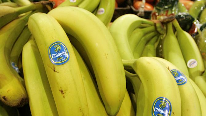 FILE - Chiquita bananas are on display at a grocery store in Bainbridge, Ohio in this Aug. 3, 2005 file photo. Faced with potentially billions of dollars in legal liability, Chiquita Brands International is asking a federal appeals court to block lawsuits filed against it in the U.S. by thousands of Colombians whose relatives were killed in that country's bloody, decades-long civil war. The produce giant, which long had huge banana plantations in Colombia, has admitted paying a right-wing Colombian paramilitary group $1.7 million over a seven-year period. (AP Photo/Amy Sancetta, File)