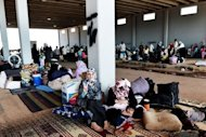 Displaced Syrian familes at the border with Turkey. Terrorised by shelling and air strikes, tens of thousands of Syrians have packed up and crossed the border to Turkey, but some have also been forced to take refuge at the actual crossing