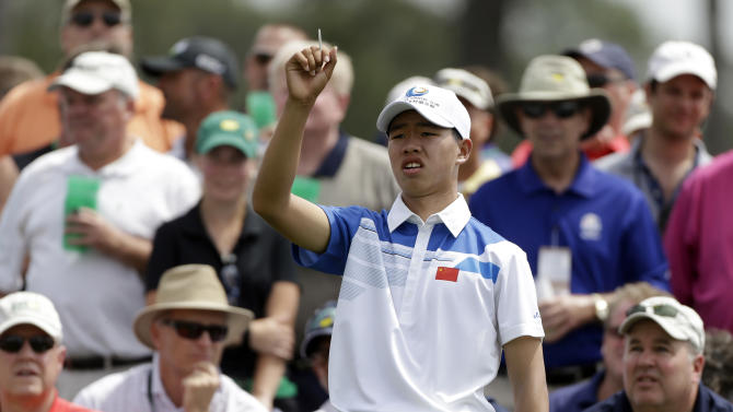 Amateur Guan Tianlang, of China, looks down the eighth fairway before teeing off during the first round of the Masters golf tournament Thursday, April 11, 2013, in Augusta, Ga. (AP Photo/David Goldman)