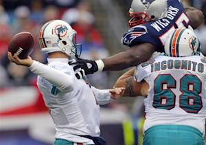 Miami Dolphins Richie Incognito tries to stop New England Patriots Vince Wilfork in their NFL football game in Foxborough