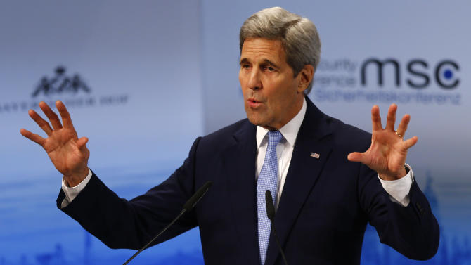U.S. Secretary of State, John Kerry  gestures during his speech   at the Security Conference in Munich, Germany, Saturday, Feb. 13, 2016. (AP Photo/Matthias Schrader)