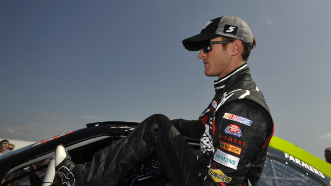 NASCAR driver Kasey Kahne climbs out of his car after his qualifying attempt at Talladega Superspeedway in Talladega, Ala., Saturday, Oct. 6, 2012. Kahne took to the pole with a speed of 191.455 mph. for Sunday's NASCAR Sprint Cup Series auto race. (AP Photo/Rainier Ehrhardt)