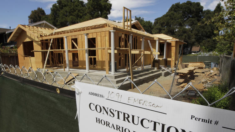 FILE-In this Tuesday, Aug. 21, 2012, photo, a new home  is under construction in Palo Alto, Calif. The average U.S. rate on the 30-year fixed mortgage held steady this week and remained slightly above the lowest level on record. (AP Photo/Paul Sakuma, File)