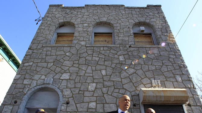 Newark Mayor Cory Booker stands in front of a boarded-up 433 Hawthorne Avenue in Newark, N.J., Friday, April 13, 2012 as he talks about rescuing a neighbor Thursday from a fire at the home. Boooker said Friday he feared for his life as he helped rescue a neighbor from a fire before firefighters arrived. Booker described how he returned home Thursday night and saw his neighbor's home engulfed in flames. The woman Booker helped save is in stable condition. (AP Photo/Mel Evans)