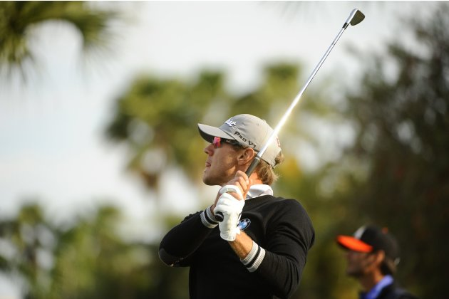 DeLaet of Canada hits his tee shot on the 15th hole during the third round of play in the Honda Classic PGA golf tournament in Florida