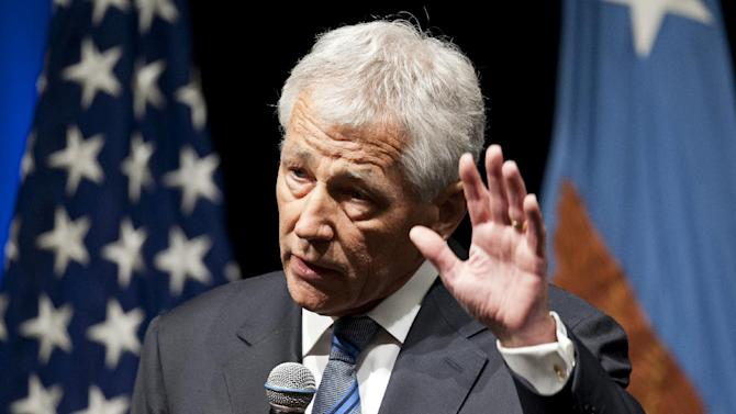 New Defense Secretary Chuck Hagel speaks to service members and civilian employees at the Pentagon, Wednesday, Feb. 27, 2013, after being sworn-in. Hagel took charge of the Defense Department Wednesday after a bruising confirmation fight _ and two days before billions in budget cuts are scheduled to hit the military. (AP Photo/Cliff Owen)