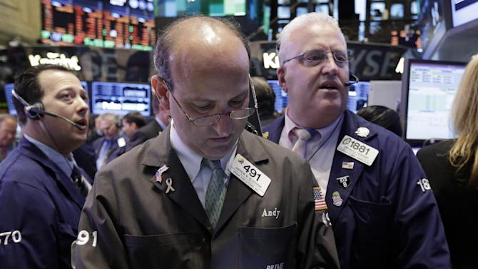 Andrew Silverman, center, works with fellow traders on the floor of the New York Stock Exchange Wednesday, April 10, 2013. Stocks are opening higher on Wall Street, a day after the Dow Jones industrial average closed at its second all-time high in a week. (AP Photo/Richard Drew)