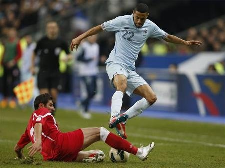 Georgia's Lobjanidze tackles France's Clichy during their 2014 World Cup qualifying match at the Stade de France stadium in Saint-Denis