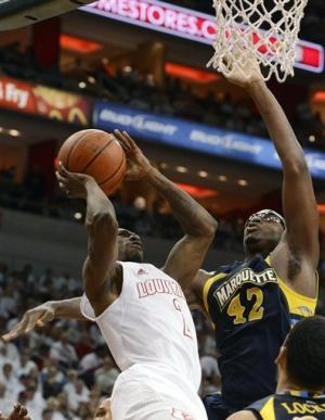 No. 12 Louisville routs No. 25 Marquette 70-51