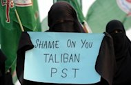A veiled activist of an Islamic Sunni Tehreek party demonstrates against the assassination attempt on Malala Yousafzai during a protest rally in Islamabad