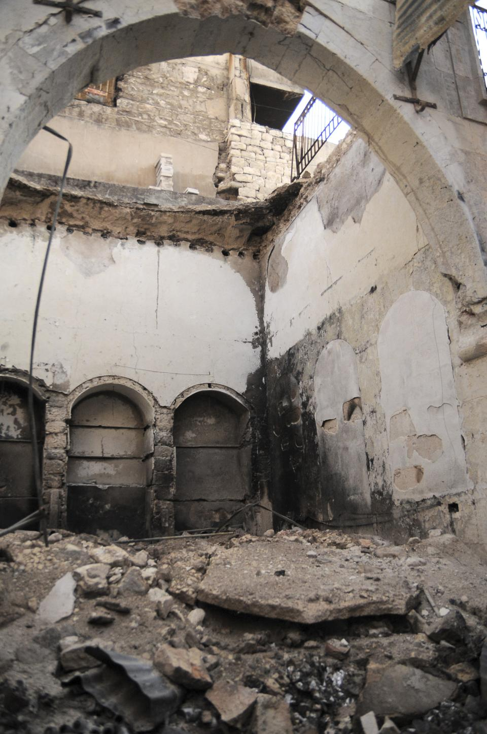 In this Tuesday, Nov. 6, 2012 photo, a general view of a destroyed building inside the Old City of Aleppo, Syria, a listed UNESCO World Heritage Site that was gutted in October and which is now controlled by the Free Syrian Army.(AP Photo/Monica Prieto)
