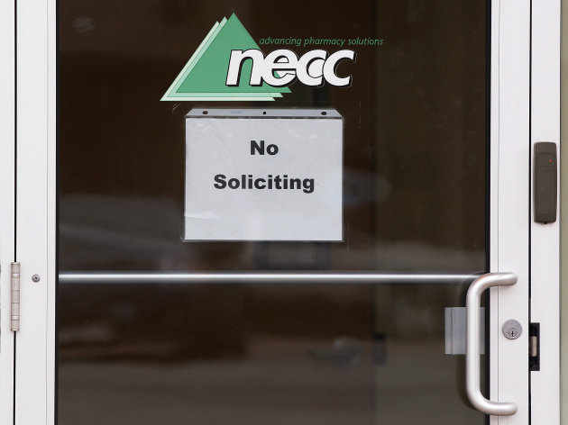 "FILE-In this Thursday, Oct. 4, 2012, file photo, a sign requesting ""No Soliciting"" hangs on the door of the New England Compounding Center, the pharmacy that distributed a steroid linked to an outbreak of fungal meningitis, in Framingham, Mass. The New England Compounding Center announced Saturday, Oct. 6, 2012, in a news release a voluntary recall of all of its products. The company said in a news release that the move was taken out of an abundance of caution because of the risk of contamination. It says there is no indication that any other products have been contaminated. (AP Photo/Stephan Savoia, File)"