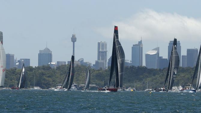 Comanche races against other yachts at the Sydney to Hobart Yacht Race in Sydney Harbour
