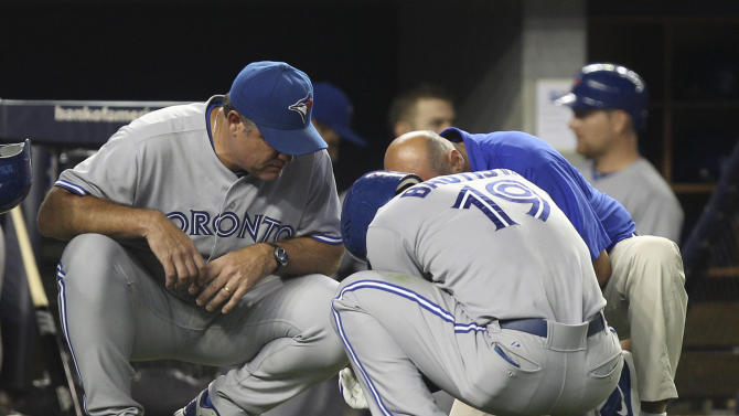 Toronto Blue Jays' manger John Farrell, left, talks with Jose Bautista after he injured his wrist during the eighth inning of the baseball game against the New York Yankees Monday, July 16, 2012 at Yankee Stadium in New York.  (AP Photo/Seth Wenig).