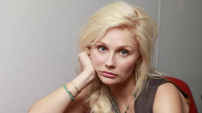 "In this Nov. 19, 2012 photo, Australian actress and singer Clare Bowen, who stars as Scarlett O'Connor in the ABC drama series ""Nashville,"" poses for a photo in Los Angeles.  The music of ""Nashville"" has been as much a star on the hourlong ABC drama as Connie Britton, Hayden Panettiere, Charles Esten, Jonathan Jackson, Bowen and Sam Palladio. Yes, each really does sing his or her own part, and so far fans seem to be responding, buying more than 800,000 digital singles. (AP Photo/Damian Dovarganes)"