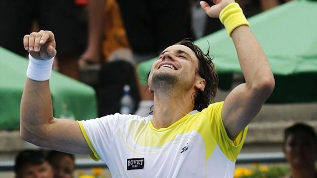 Spain's David Ferrer celebrates beating Germany's Philipp Kohlschreiber in the final of the Heineken Open in Auckland (Reuters)