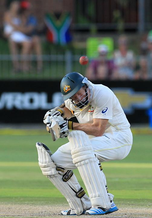Australia's batsman Chris Rogers ducks under a bouncer from South Africa's bowler Dale Steyn, on the fourth day of their second cricket test match at St George's Park in Port Elizabeth, So