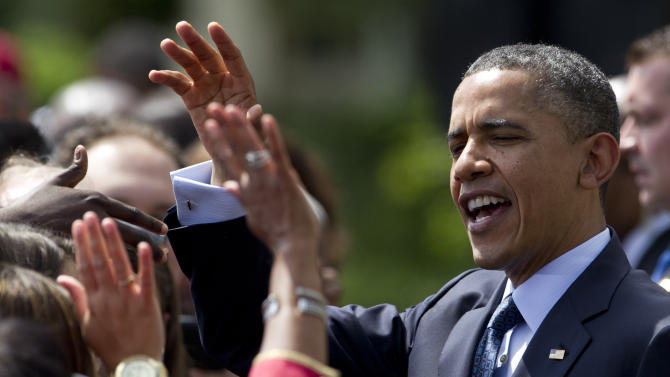 President Barack Obama greets the crowd after a ceremony to honor the NCAA College football BCS National Champion University of Alabama Crimson Tide, Thursday, April 19, 2012, on the South Lawn of the White House in Washington. (AP Photo/Carolyn Kaster)