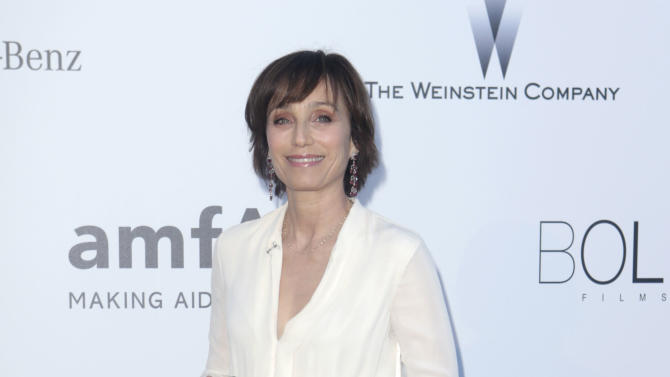 Actress Kristin Scott Thomas arrives at amfAR Cinema Against AIDS benefit at the Hotel du Cap-Eden-Roc, during the 66th international film festival, in Cap d'Antibes, southern France, Thursday, May 23, 2013. (Photo by Joel Ryan/Invision/AP)