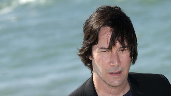 Actor Keanu Reeves poses for photographers during a photo call for the film Man of Tai Chi at the 66th international film festival, in Cannes, southern France, Monday, May 20, 2013. (Photo by Joel Ryan/Invision/AP)