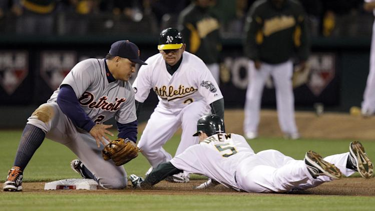 Oakland Athletics' Stephen Drew, right, is out at third on a tag by Detroit Tigers third baseman Miguel Cabrera after Drew hit a double to drive in a run in the sixth inning of Game 4 of an American League division baseball series in Oakland, Calif., Wednesday, Oct. 10, 2012. (AP Photo/Ben Margot)