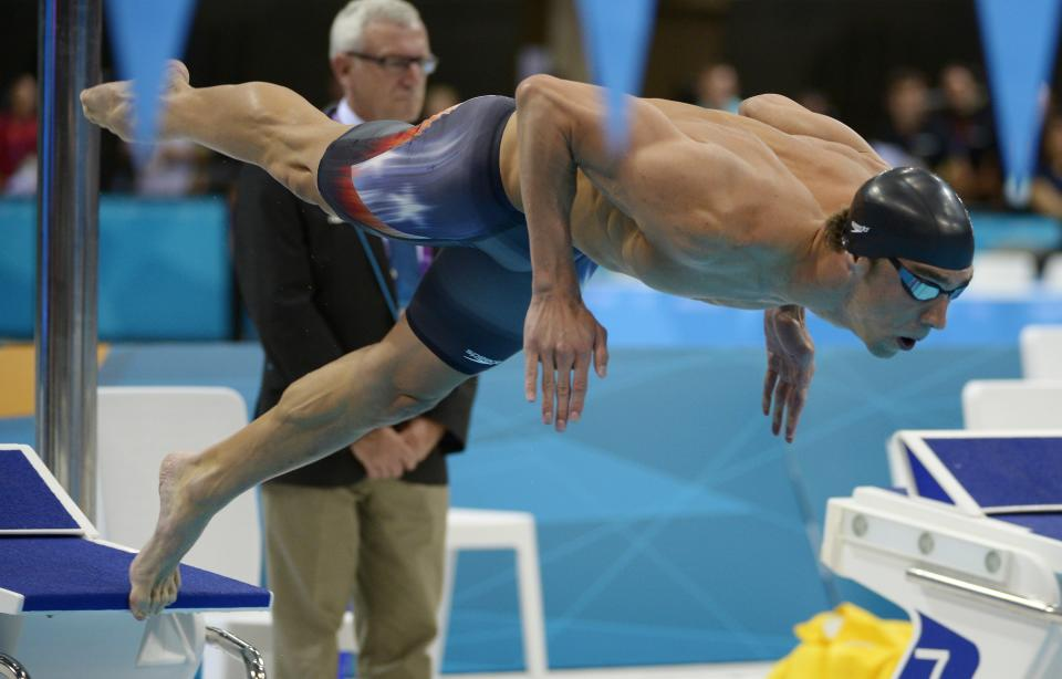 United States' Michael Phelps starts in the men's 400-meter individual medley swimming final at the Aquatics Centre in the Olympic Park during the 2012 Summer Olympics in London, Saturday, July 28, 2012. (AP Photo/Mark J. Terrill)