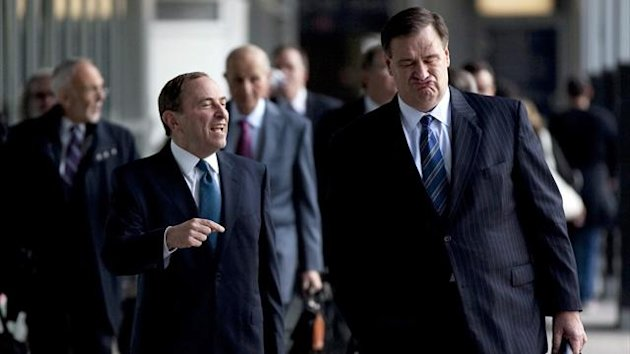 NHL Commissioner Gary Bettman, left foreground, and Calgary Flames co-owner Murray Edwards arrive for negotiations with the NHL Players Association in Toronto Thursday Oct. 18, 2012. The NHL Players&#39; Association confirmed it will make a new offer during n