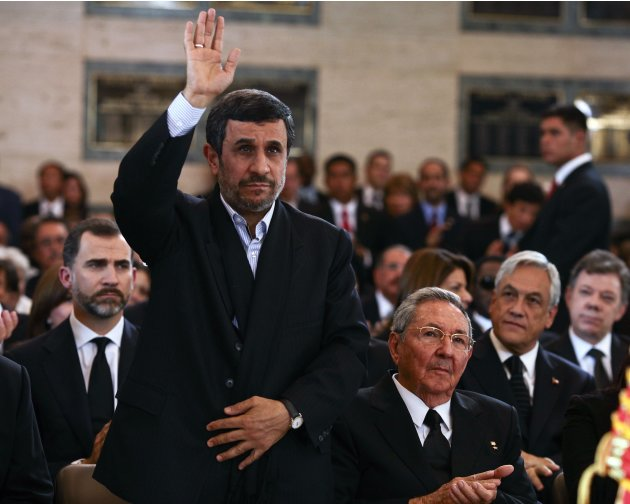 Iran&amp;#39;s President Mahmoud Ahmadinejad waves as he arrives with other leaders for the funeral of late President Chavez in Caracas