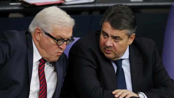German Foreign Minister Steinmeier and Economy Minister Gabriel attend a session of the German lower house of parliament, the Bundestag, in Berlin