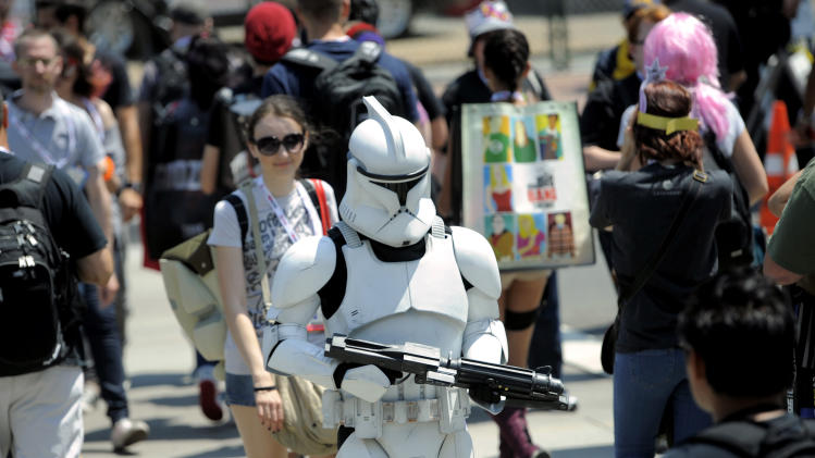 A Stormtrooper makes his way through the crowd during Day 2 of Comic-Con International on Thursday, July 18, 2013 in San Diego, Calif. (Photo by Chris Pizzello/Invision/AP)