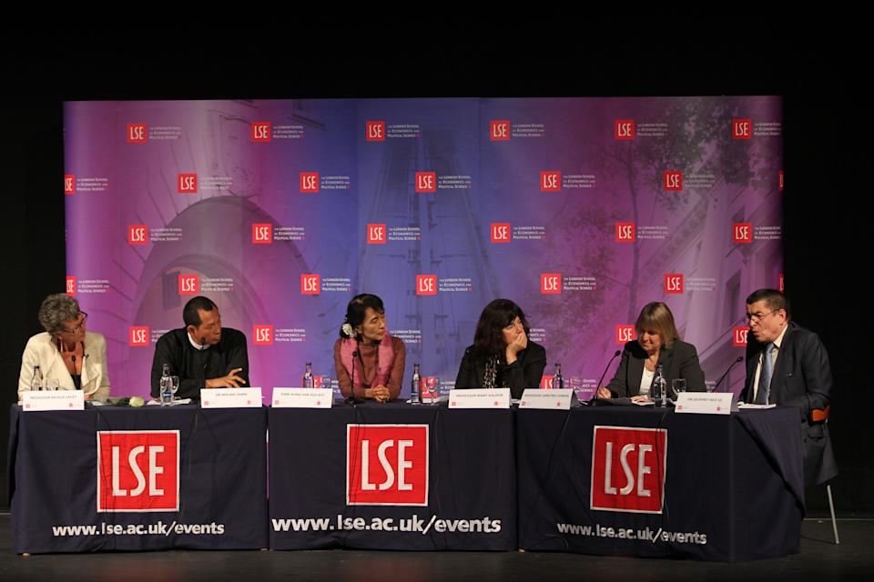 Myanmar political leader Aung San Suu Kyi, third from left to right, takes part in a round table at The London School of Economics and Political Science during the first public event of her UK  visit in London Tuesday June, 19, 2012. (AP Photo/Elizabeth Dalziel)