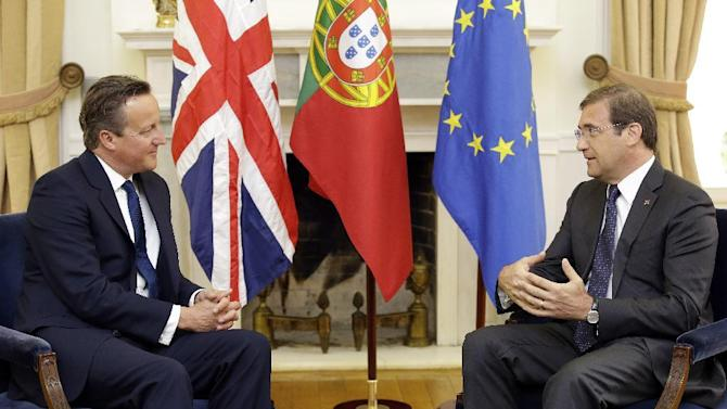 British Prime Minister David Cameron, left, meets with his Portuguese counterpart Pedro Passos Coelho at the Sao Bento palace in Lisbon, Friday, Sept. 4, 2015. (AP Photo/Armando Franca)