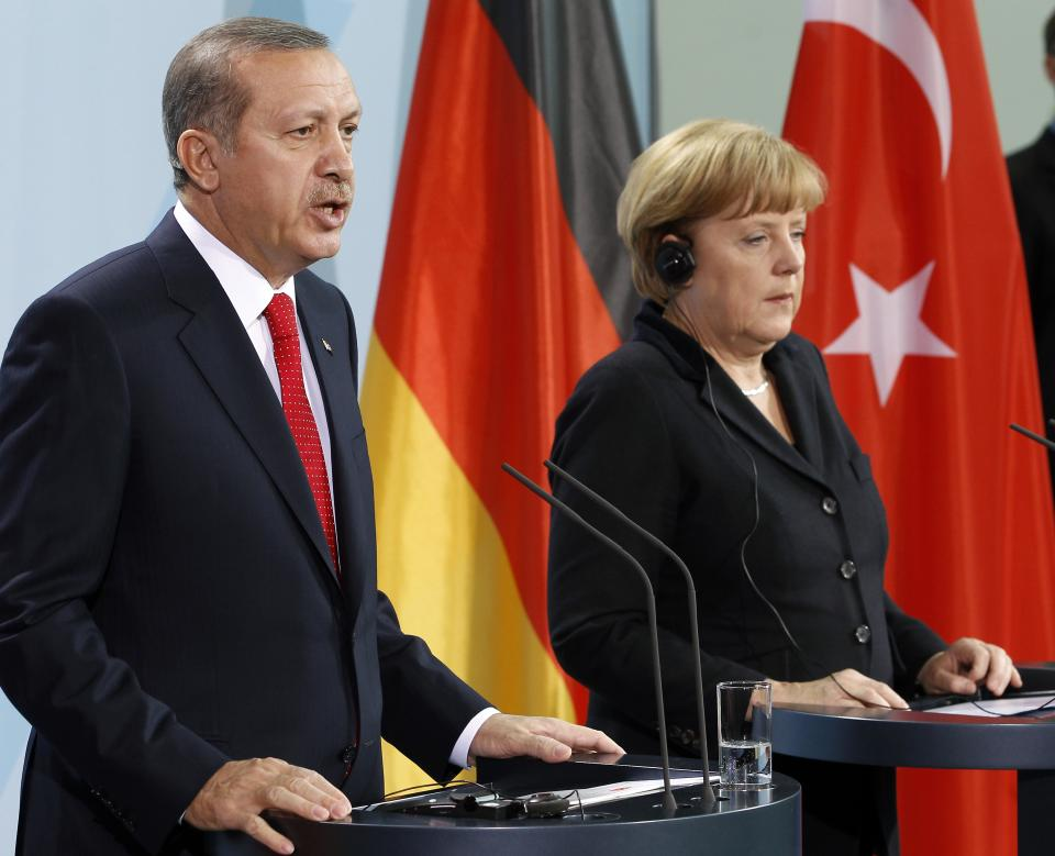 German Chancellor Angela Merkel, right, and Turkey's Prime Minister Recep Tayyip Erdogan, left, address the media during a joint press conference after a meeting at the chancellery in Berlin, Germany, Wednesday, Oct. 31, 2012. (AP Photo/Michael Sohn)
