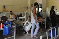 A patient lies on a bed at a public hospital in Yangon. During almost half a century of military rule which ended last year, Myanmar&#39;s junta funnelled cash to the armed forces but presided over one of the world&#39;s lowest outlays on public health