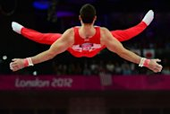 Great Britain's gymnast Kristian Thomas competes at the horizontal bar during the men's team final of the artistic gymnastics event of the London Olympic Games at the 02 North Greenwich Arena in London. Britain won bronze